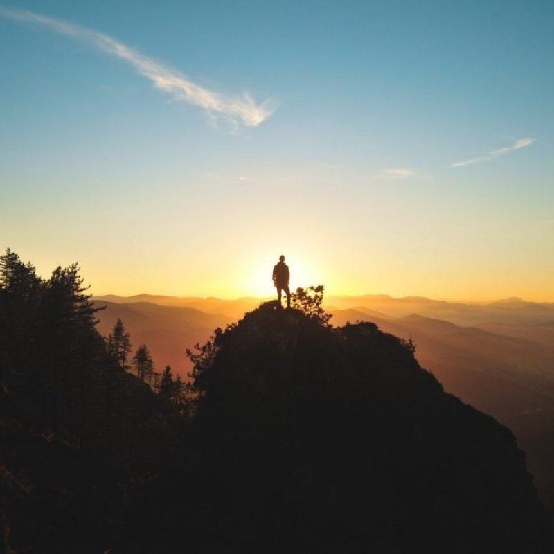 adventure-standing-sunset